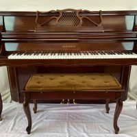 This Charles Walter console is in great condition and has been restored by a highly acclaimed local piano restorer. This console is the piano tuners recommendation for artists that enjoy playing and practicing.